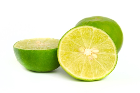 fresh green lemon limes isolated on white background photo