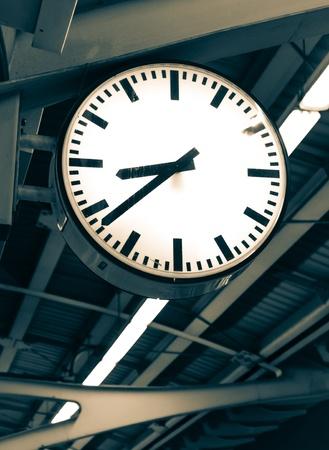 clock in railway station Stock Photo