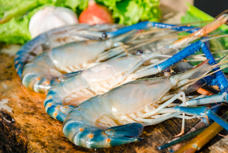 Seafood fresh shrimps laying on wood board