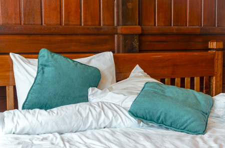 bedlinen: pillows and blankets on the messy bed