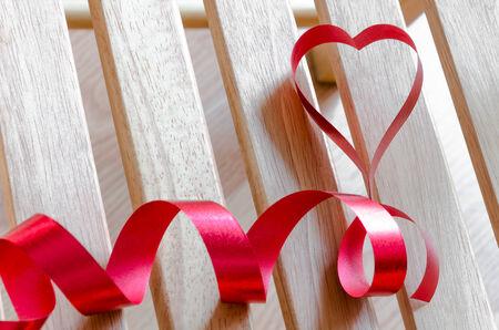 Red satin ribbon heart shaped