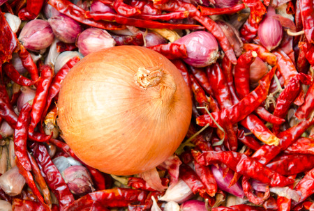 big onion placed on dried chillies