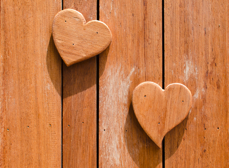 wooden hearts shaped on wooden background