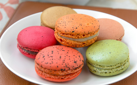 sweet colourful macarons in the white plate