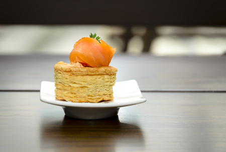 bite size party food smoked salmon and cream cheese on crackers Stock Photo