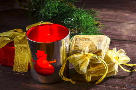 Christmas decorations candle in jar and gift box