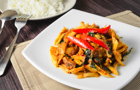 Thai food Stir fried pork and bamboo shoots with chilli curry served with rice
