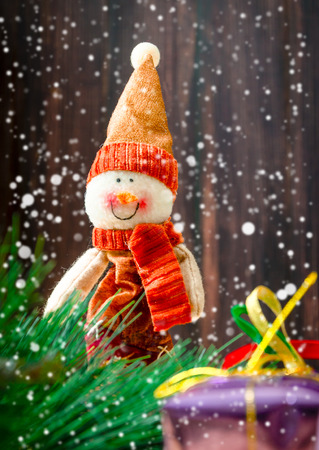 snowman doll stand at snowfall winter day Stock Photo
