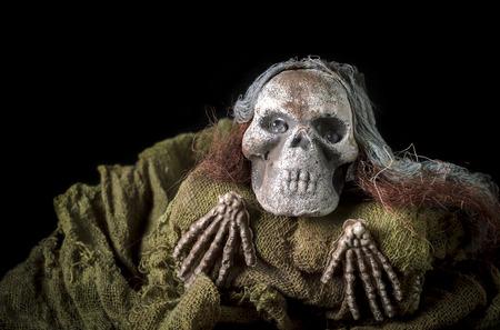 halloween human skeleton on fabric over black background Stock Photo