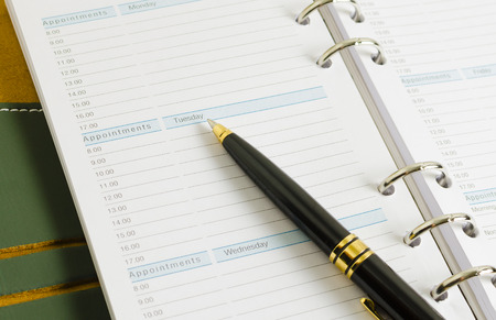 close up shot of daily notebook with pen focus on appointments wording business concept Stock Photo