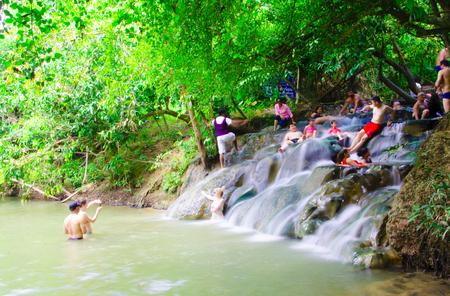 Krabi,Thailand Febuary 11 2016:Tourist enjoying the hot springs waterfall at Klongtom,Krabi Province,Thailand