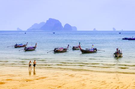 KRABI,THAILAND FEB 12,2016:Tourist walking and relaxing on the Ao Nang Beach. Ao Nang Beach is the busiest beach destination in Thailands Krabi Province