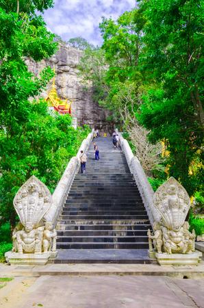 Saraburi,Thailand December 3, 2016:People walking up on the stairs to visit The Wat Phar Phutthachai temple. Wat Phar Phutthachai temple is located on hill of Khao Patthawi in Tambon Nong Pla Lai,Saraburi Province Thailand