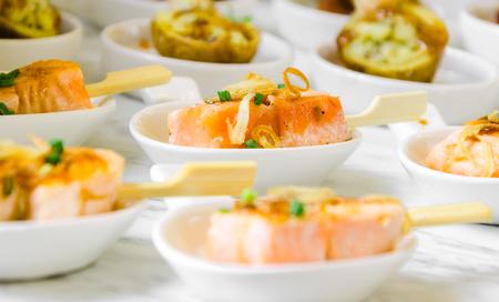 mini fingerfood buffet sticky smoked salmon Stock Photo