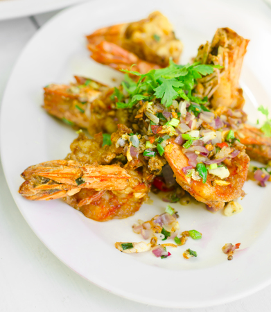 shrimp fried salt with pepper and herbs