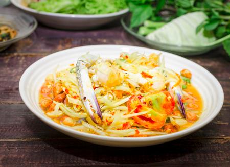 Thai traditional food papaya salad with raw crab