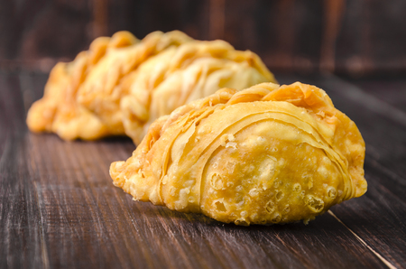 curry puff pastry on wooden board background Stock Photo