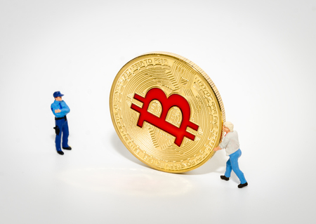 miniature police officer arresting theif stealing bitcoin. digital currency blockchain crytocurrencies security concept
