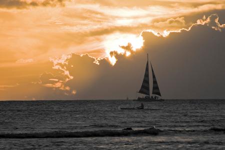 Yacht at Sunset on Waikiki Beach Stock Photo