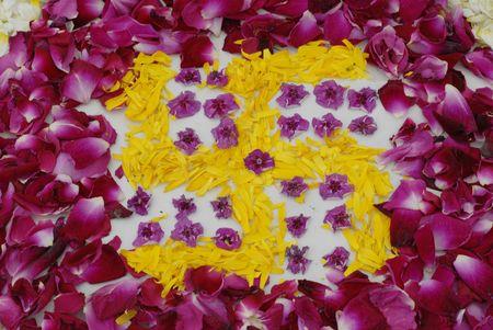 vivre: Rose petals swastika rangoli decoration Ikebana Stock Photo