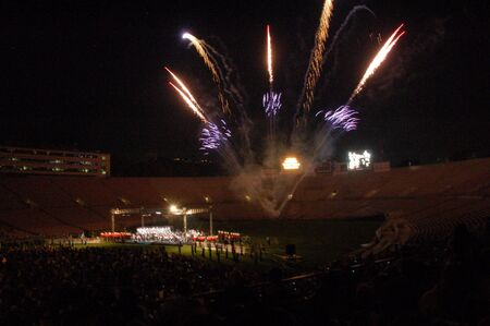 Fireworks lighting stadium at night