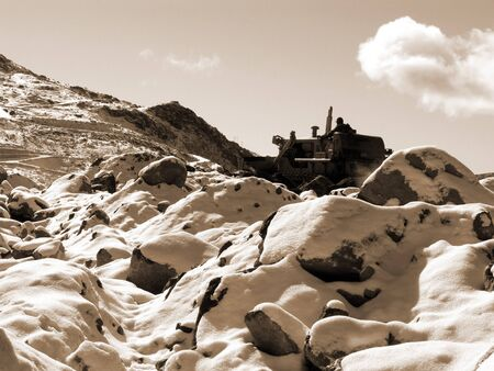 A bulldozer vehicle clearing Snow on mountains in Gangtok Sikkim India Stock Photo - 4524391