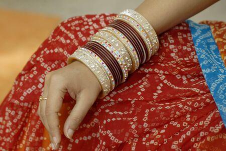 woman wearing colorful indian sari and designer bangles Stock Photo