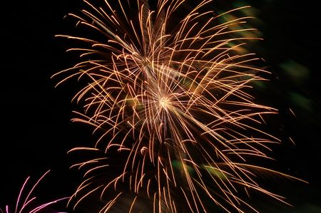 Fireworks in golden color lighting the sky photo
