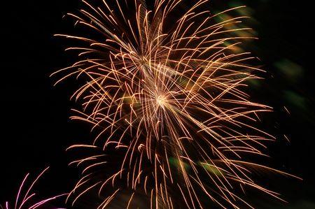 Fireworks in golden color lighting the sky