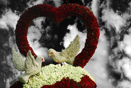 lovebirds: valentine birds and heart shaped Flower decoration with roses