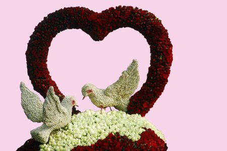 valentine birds and heart shaped Flower decoration with roses photo