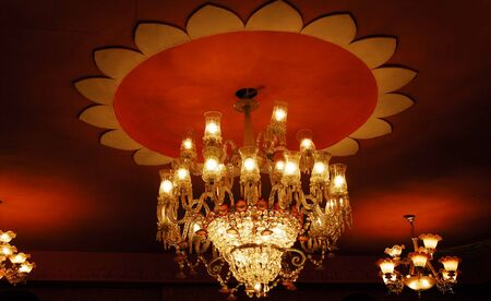 isolated shot of Home interiors Chandelier on ceiling photo