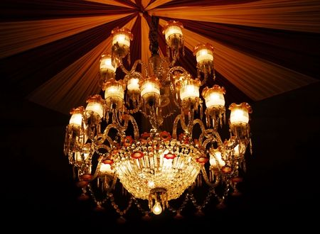 crystal background: isolated shot of Home interiors Chandelier on ceiling Stock Photo