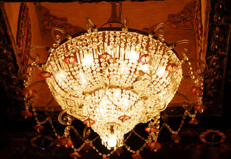 isolated shot of Home interiors Chandelier on ceiling Stock Photo