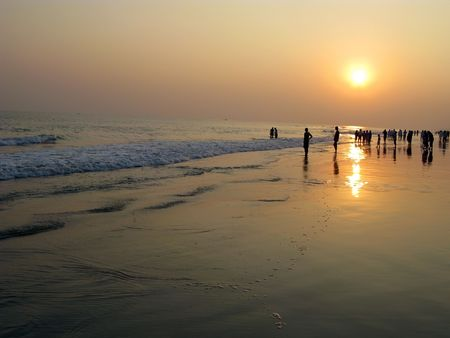 people enjoying sunset view in evening at puri sea beach Odisha India