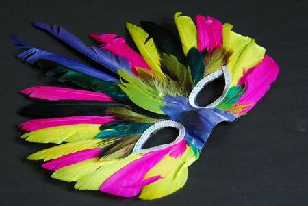 a colorful feather mask isolated on white background photo