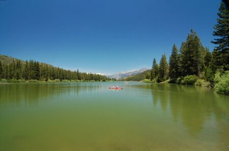 Couple Boating in Hume Lake in Sequoia National Park in California USA photo