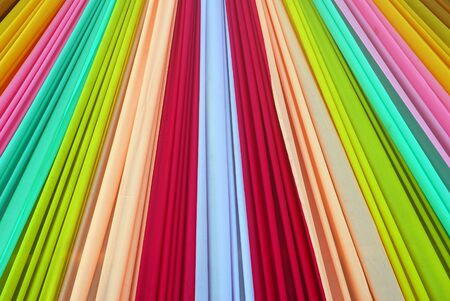 crimson colour: Ornate colorful designer curtains in multi colors Stock Photo