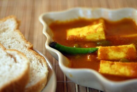 An Indian vegetarian meal with bread and Cottage Cheese Paneer photo