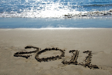 2011 new year written in sand on the beach Stock Photo - 8440715