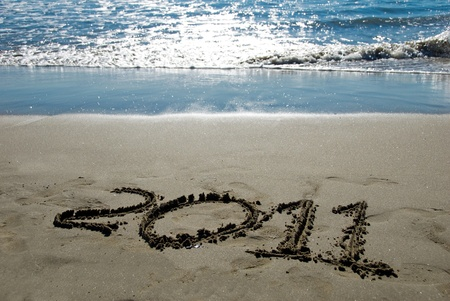 2011 new year written in sand on the beach Stock Photo - 8457851