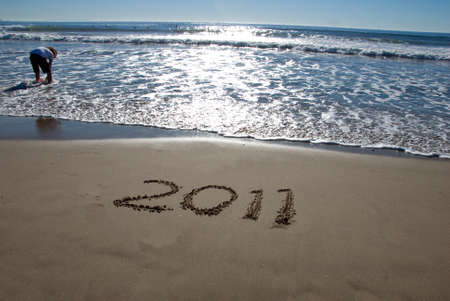 2011 new year written in sand on the beach photo