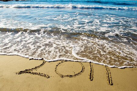 2011 new year written in sand on the beach
