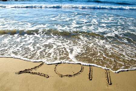 2011 new year written in sand on the beach Stock Photo - 8457861