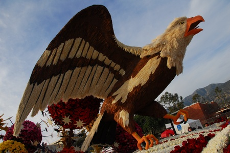 PASADENA, CAUSA - JANUARY 1:  Proud to serve those who serve Anheuser-Busch Eagle bird float at the 122nd tournament of roses Rose Parade on January 1 2011 in Pasadena California