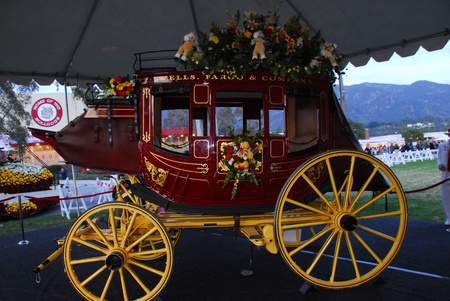 tournament of roses: PASADENA, CAUSA - JANUARY 1: Wells Fargo Bank Horse Carriage float at the 122nd tournament of roses Rose Parade on January 1 2011 in Pasadena California