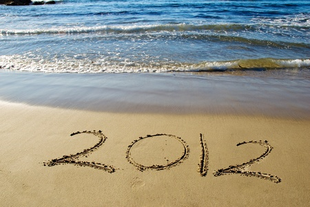2012 new year written in sand on the beach photo