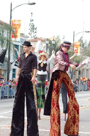 stilts: stilts clowns entertaining the crowd at Sixth Annual Chinese Lunar New Year Parade on February 18 2007 in Pasadena California. It is a celebration by the Asian American COmmunity