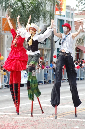 stilts clowns entertaining the crowd at Sixth Annual Chinese Lunar New Year Parade on February 18 2007 in Pasadena California. It is a celebration by the Asian American COmmunity
