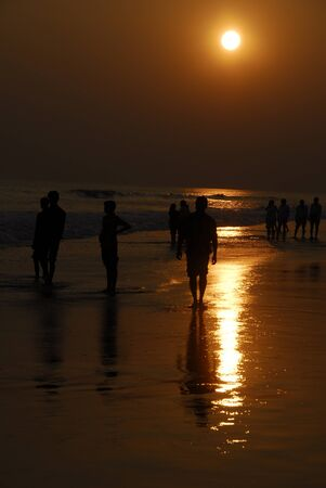 an isolated shot of People watching Sunset photo